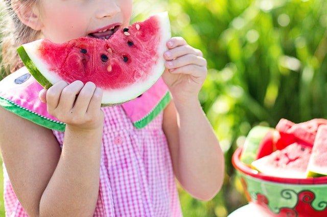 summer time, little girl eating watermelon