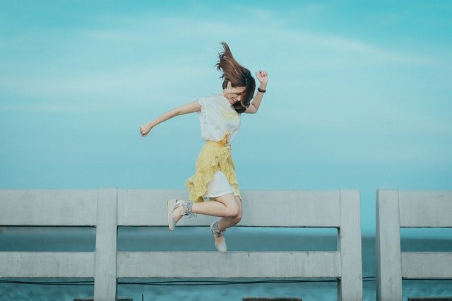 a girl jumping in the air