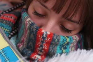 Ladies face with scarf wrapped around her nose